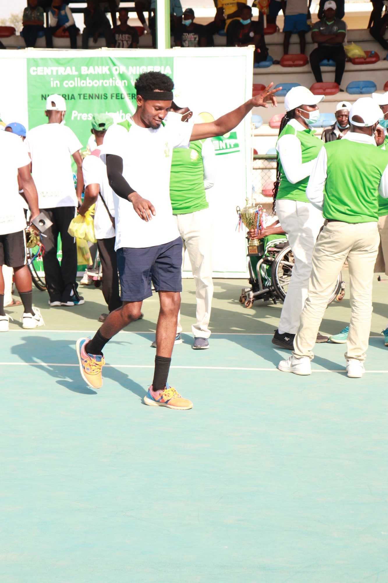 Imeh in a joyous mood to collect his trophy