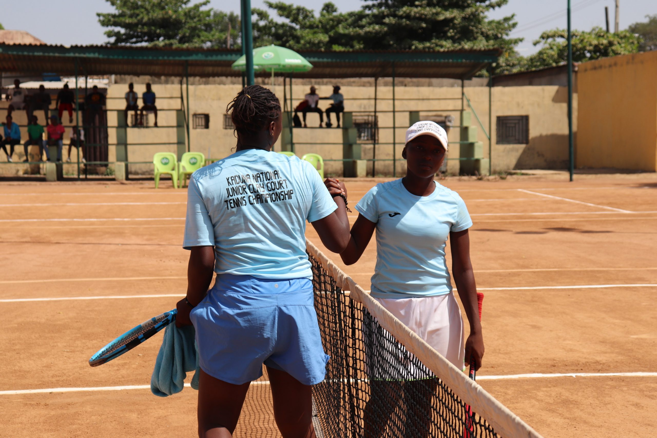 Udoffa and Azi greet at the net scaled